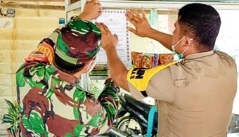 Babinsa dan Bhaminkamtibmas Polsek Rambah buat Himbauan Pencegahan Corona