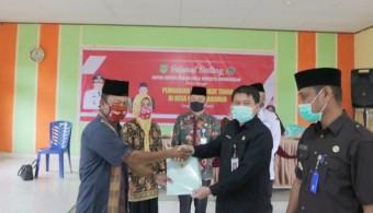 Sekda Serahkan Sertifikat Tanah Program TORA 2020 di Rambah Samo